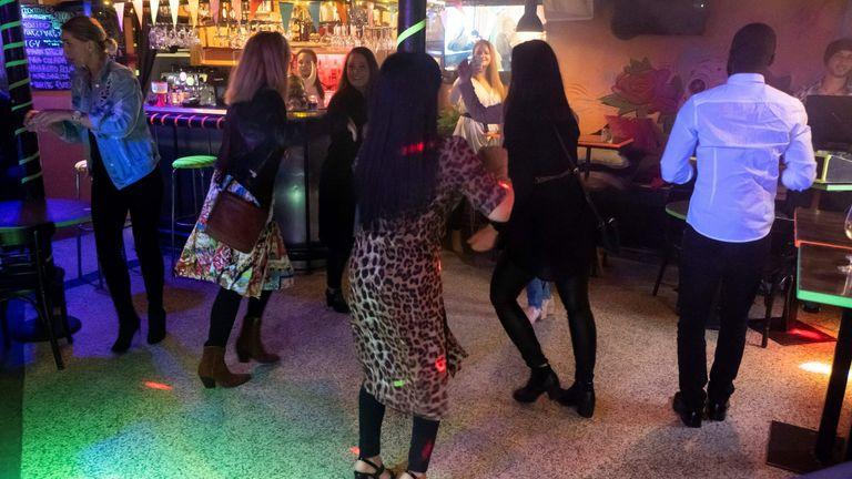 People dancing at a bar in Reykjavik, Iceland