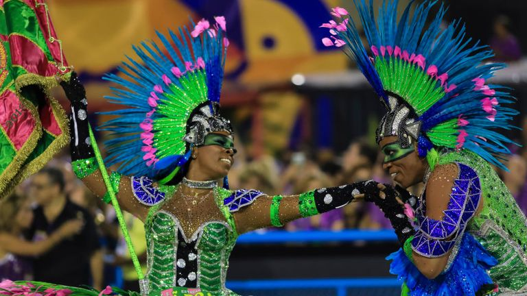 Members of Mangueira perform during the samba school's champions parade in 2019