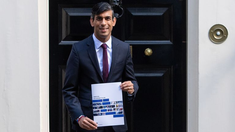 Chancellor of the Exchequer Rishi Sunak holds a copy of his Winter Economy Plan outside No 11 Downing Street before heading for the House of Commons to give MPs details of his Winter Economy Plan.