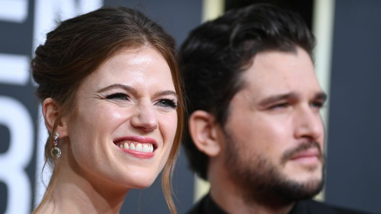 British actors Kit Harington (R) and wife Rose Leslie