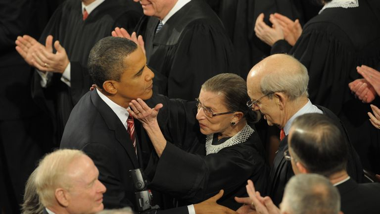 Supreme Court Justice Ruth Bader Ginsburg greets US President Barack Obama prior to delivering his first State of the Union address