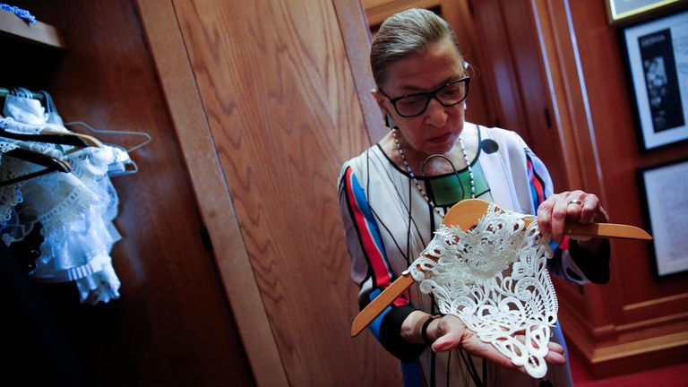 U.S. Supreme Court Justice Ruth Bader Ginsburg shows the many different collars (jabots) she wears with her robes, in her chambers at the Supreme Court building in Washington, U.S. June 17, 2016. Picture taken June 17, 2016. REUTERS/Jonathan Ernst