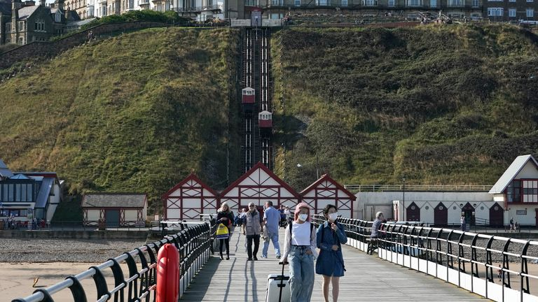 People on the pier at Saltburn-by-the-Sea at the start of a week in which the UK is expected to bask in temperatures of more than 30C