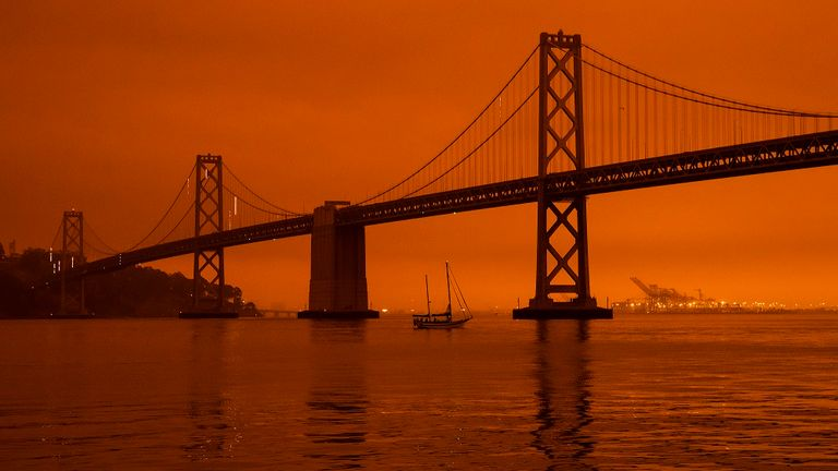 Wildfires blanket San Francisco in darkness and an orange glow