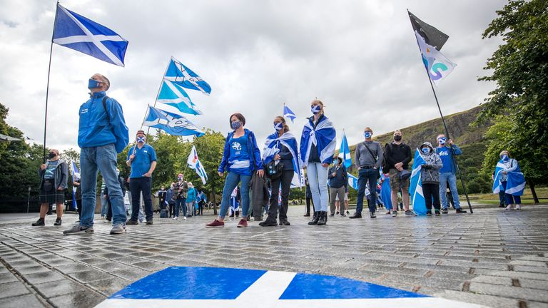 Members from All Under One Banner take part in a static demonstration for Scottish independence outside the Scottish Parliament in Edinburgh.