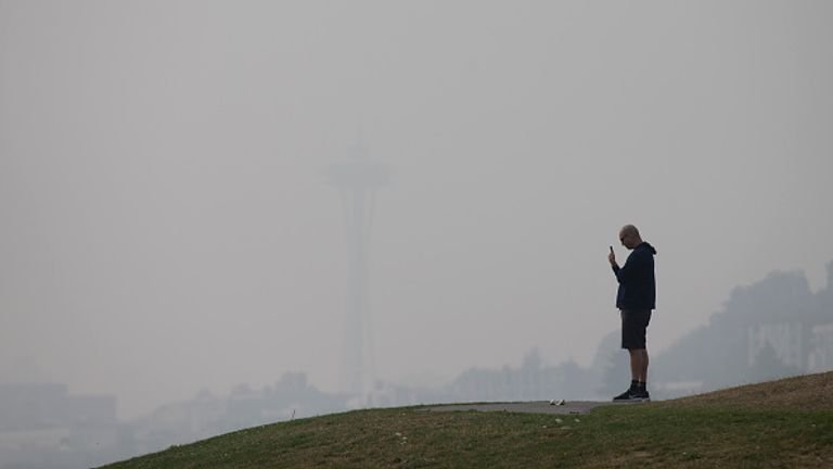 Seattle's famous Space Needle was barely visible on Friday