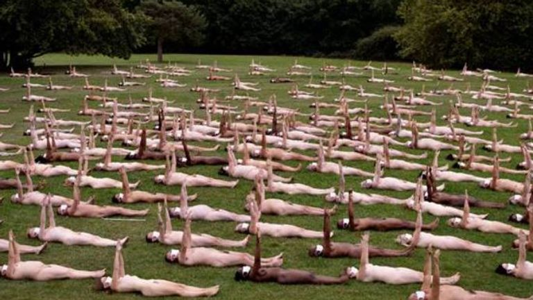 Two-hundred and twenty people pose nude except for face masks to celebrate Sky Arts move to Freeview. Pic: Spencer Tunick