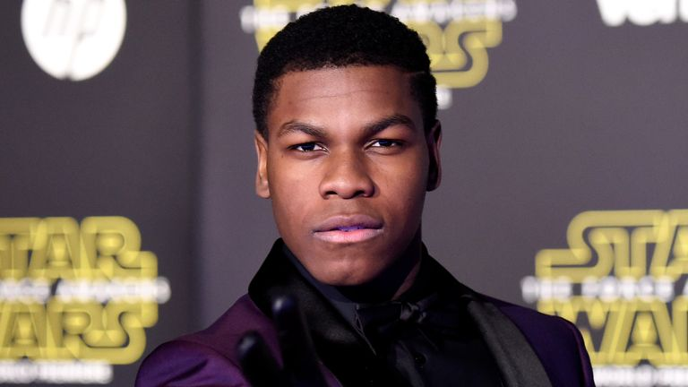 "John Boyega attends the premiere of Walt Disney Pictures and Lucasfilm's ""Star Wars: The Force Awakens"" on December 14th, 2015 in Hollywood, California"
