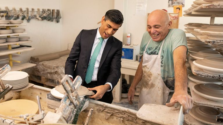 Chancellor Rishi Sunak learns the art of handling clay to make plates with Wayne Swindaill during a visit to the Emma Bridgewater pottery after employees returned back to work after being furloughed on September 14, 2020 in Stoke-on-Trent, England