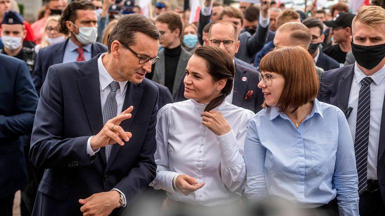Opposition leader Svetlana Tikhanovskaya with Polish prime minister Mateusz Morawiecki (L) in Warsaw on Wednesday