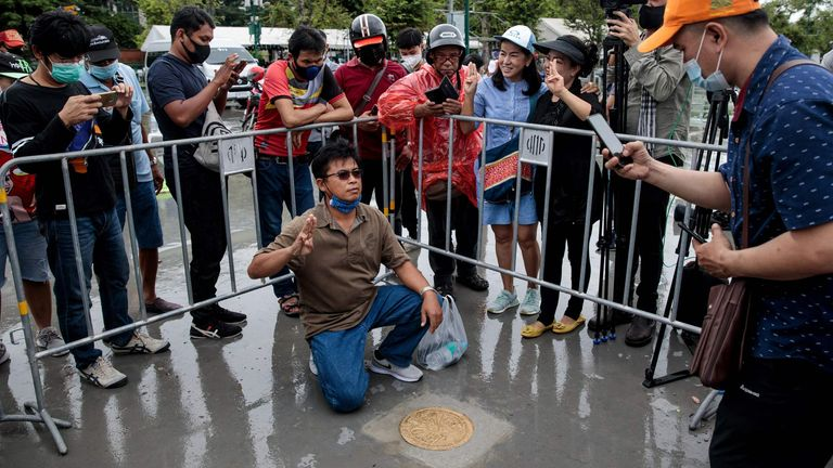 People take photos with a commemorative plaque placed by pro-democracy protest leaders