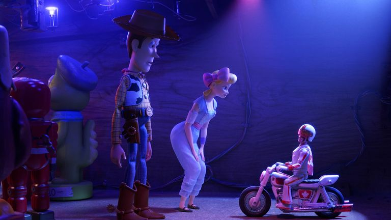 Woody (Tom Hanks), Bo Peep (Annie Potts) and Duke Caboom (Keanu Reeves)