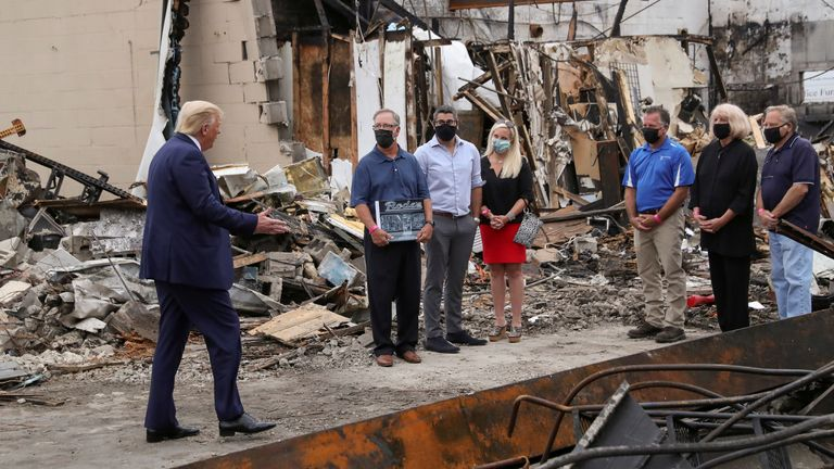 Donald Trump is seen speaking to John Rode III (centre) about the violence in Kenosha