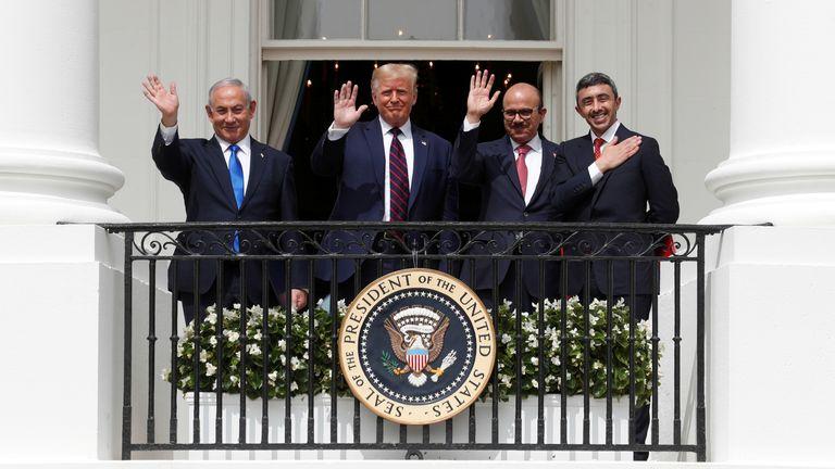 Benjamin Netanyahu, Donald Trump, Abdullatif Al Zayani and Abdullah bin Zayed wave from the White House balcony after signing the Abraham Accords