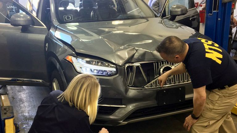 Investigators examine the self-driving car involved in the fatal crash