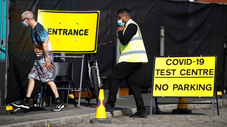 A man arrives at a walk-in test facility following the outbreak of the coronavirus disease (COVID-19) in the Farnworth area of Bolton, Britain, September 15, 2020. REUTERS/Phil Noble