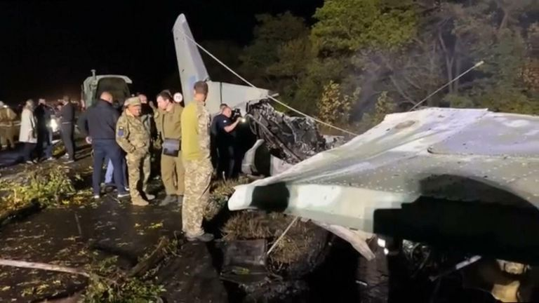A Ukrainian military plane carrying aviation school students crashed and burst into flames on Friday while landing, killing 22 people, the country's emergencies service said.