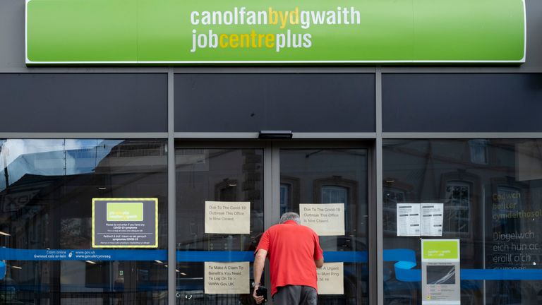 A man looks through the window of the Job Centre Plus on August 18, 2020 in Bargoed, Wales.