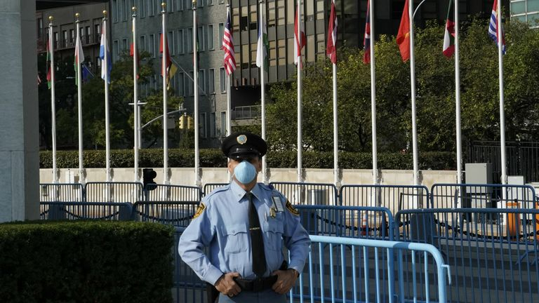 A UN police officer stands at an empty entrance at the United Nations September 22, 2020 during the the 75th General Assembly of the United Nations which will be mostly virtual due to the covid-19 pandemic in New York.