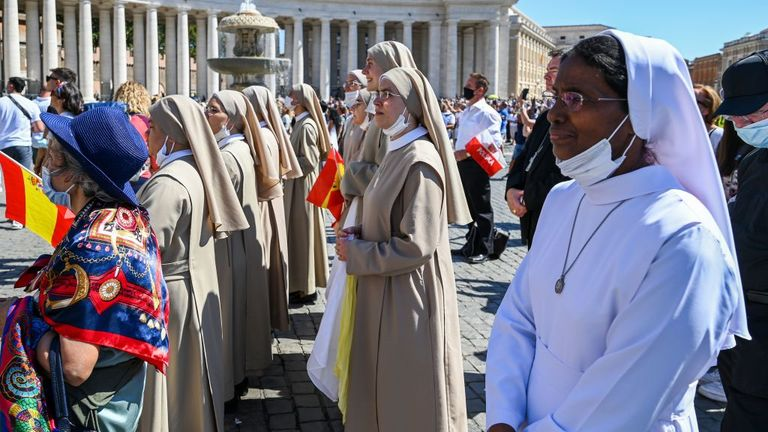 Nuns and worshippers gather to listen to the Pope's address