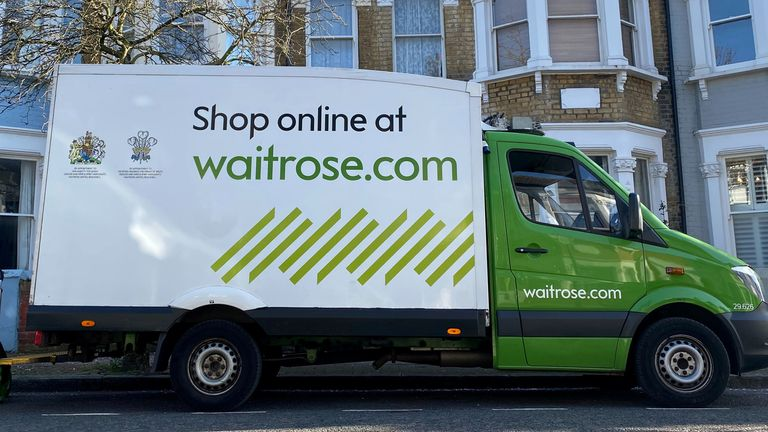 A driver packs away boxes after delivering Waitrose groceries to a house in Hackney, London, Britain, as the spread of the coronavirus disease (COVID-19) continues, March 24, 2020