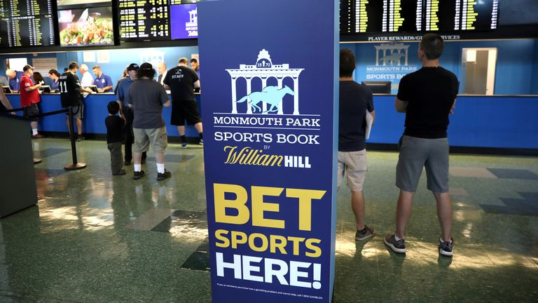 Gamblers place bets on sports at Monmouth Park Sports Book by William Hill, shortly after the opening of the first day of legal betting on sports in Oceanport, New Jersey, US
