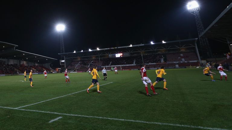 of Wrexham AFC challenges of Oxford United during the FA Cup Second Round match between Wrexham AFC and Oxford United at Racecourse Ground on December 9, 2013 in Wrexham, Wales.