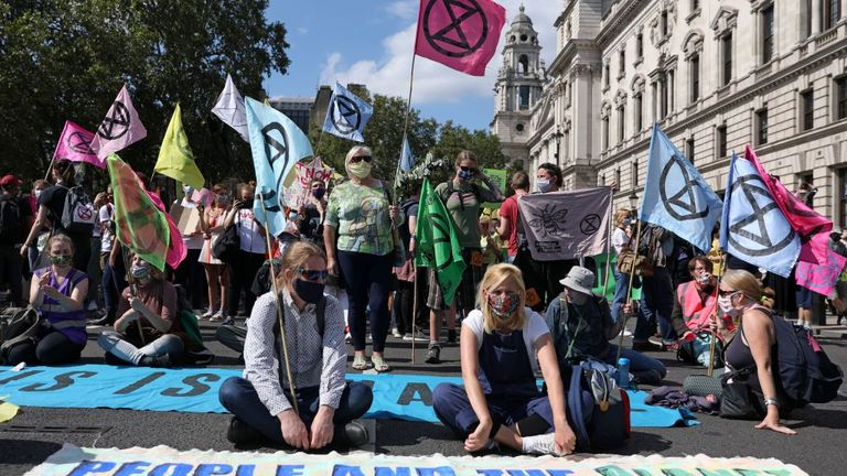 Extinction Rebellion activists sit in the road near Parliament Square