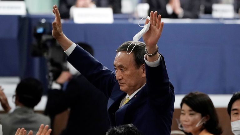 Japanese Chief Cabinet Secretary Yoshihide Suga acknowledges as he is elected as new head of Japan...s ruling party at the Liberal Democratic Party's (LDP) leadership election Monday, Sept. 14, 2020, in Tokyo. (AP Photo/Eugene Hoshiko, Pool)
