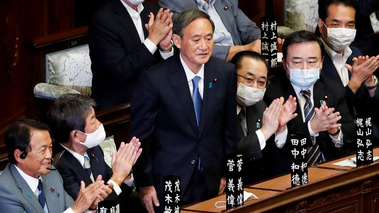Yoshihide Suga stands in parliament in Tokyo following his appointment as Japan's new prime minister