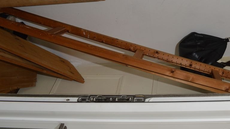 A ladder and other pieces of furniture were blocking the cupboard where the freezer was