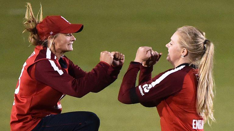 England Women's spinner Sarah Glenn (R) celebrates a wicket with Danni Wyatt