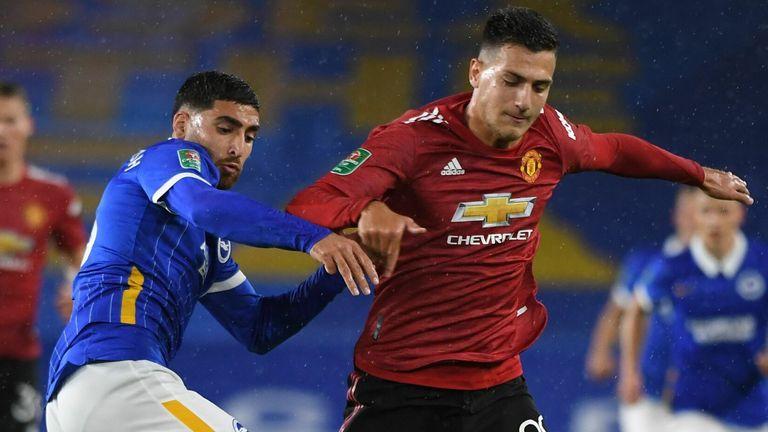 Brighton midfielder Alireza Jahanbakhsh (L) vies with Manchester United's Diogo Dalot