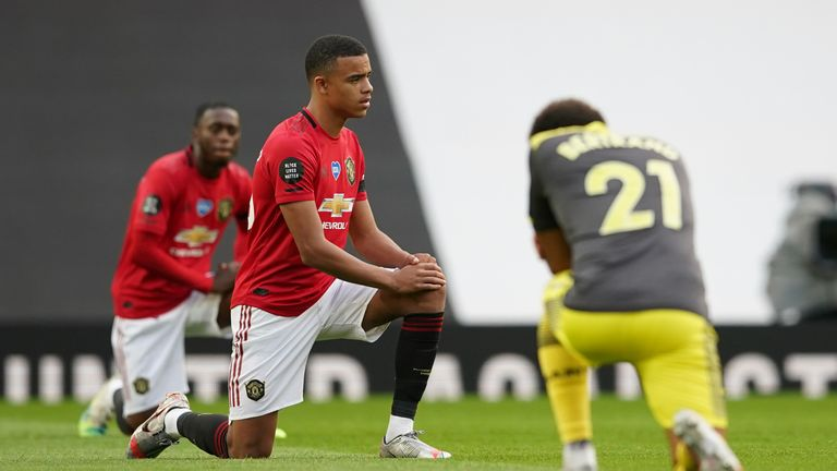 Mason Greenwood takes a knee before Manchester United's game against Southampton