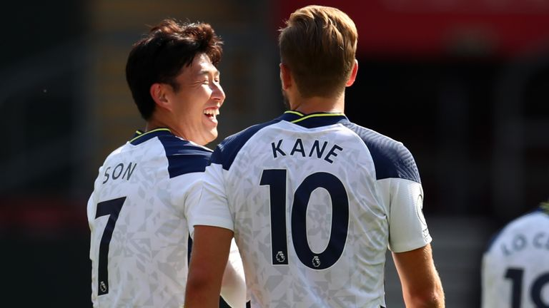 Heung-Min Son and Harry Kane walk back to the half-way line after the Spurs no.10 scores their fifth goal