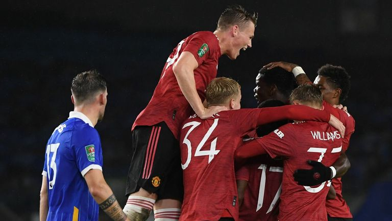 Manchester United celebrate as Paul Pogba makes it 3-0 against Brighton