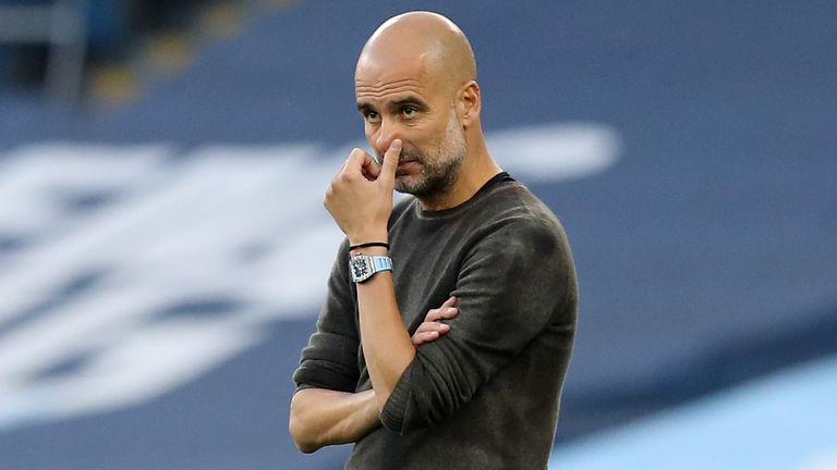 Pep Guardiola looks on with his side trailing Leicester City at the Etihad