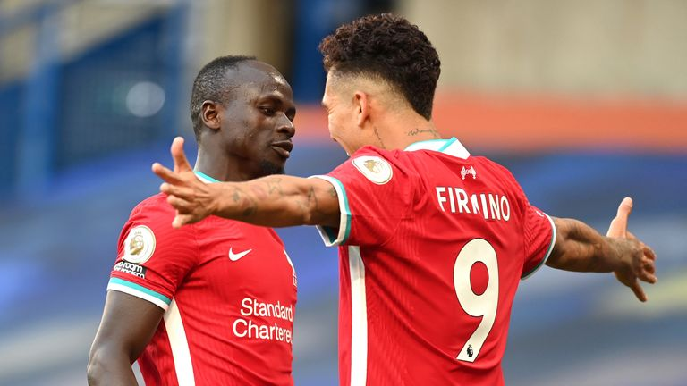 Sadio Mane celebrates with Roberto Firmino after scoring the opening goal of the game