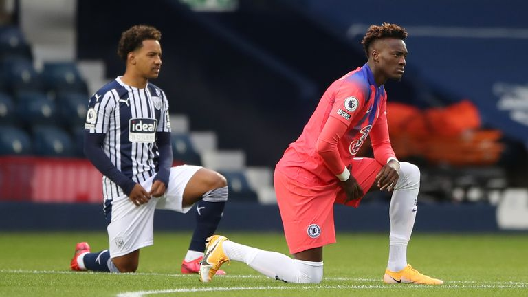 Chelsea's Tammy Abraham and West Brom's Matheus Pereira take the knee before kick-off in support of Black Lives Matter