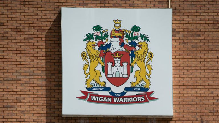 WIGAN, ENGLAND - JULY 06: The club crest of Wigan Warriors RLFC outside the DW Stadium, home of Wigan Athletic FC and Wigan Warriors RLFC on July 6, 2020 in Wigan, United Kingdom. (Photo by Visionhaus)