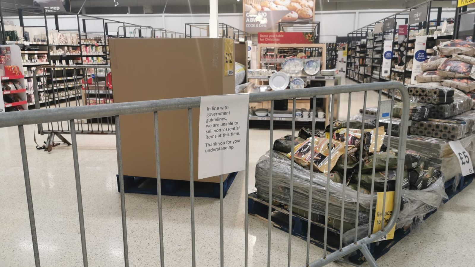 "Shoppers in Wales have criticised government measures which mean ""non-essential items"" have been put behind metal barriers or covered with plastic sheeting in supermarkets"