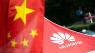 A logo of Huawei Technologies Co Ltd is seen next to a Chinese flag in Shanghai on October 1, 2014. The founder of Chinese telecommunications giant Huawei announced plans to invest 1.5 billion euros ($1.9 billion) in France to develop smartphones, the online edition of Les Echos business daily reported Monday. AFP PHOTO / JOHANNES EISELE (Photo by Johannes EISELE / AFP) (Photo credit should read JOHANNES EISELE/AFP via Getty Images)