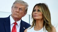 """US President Donald Trump and First Lady Melania Trump watch as planes flyover during the 2020 """"Salute to America"""" event in honor of Independence Day on the South Lawn of the White House in Washington, DC, July 4, 2020. (Photo by SAUL LOEB / AFP) (Photo by SAUL LOEB/AFP via Getty Images)"""