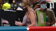 Voters casting early ballots in Florida, one of the states in which voters received emails