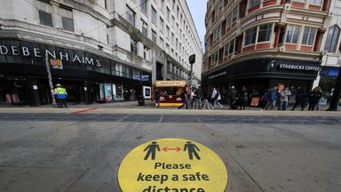 A social distancing guidance sign on the pavement in Manchester city centre. Cities in northern England and other areas suffering a surge in Covid-19 cases may have pubs and restaurants temporarily closed to combat the spread of the virus.