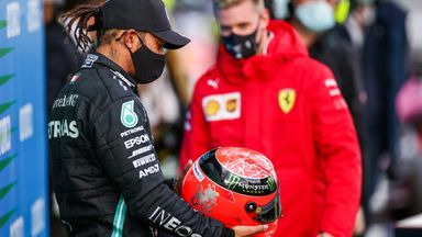 Hamilton presented with Schumacher helmet