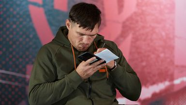 Usyk on phone during Haye speech!