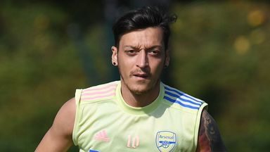 Why is Ozil not in Arsenal's squad?