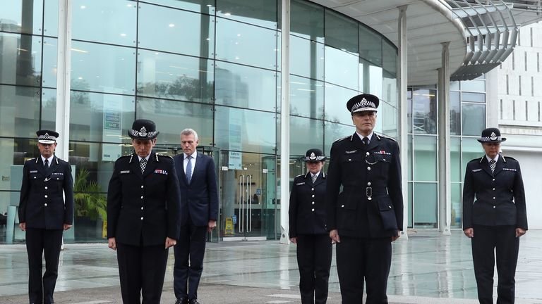 Metropolitan Police Commissioner Dame Cressida Dick (2nd left) and her colleagues (L-R) Assistant Commissioner Nick Ephgrave; Robin Wilkinson, Chief of Corporate Services, Metropolitan Police Service; Assistant Commissioner Louisa Rolfe; Deputy Commissioner Sir Steve House and Assistant Commissioner Helen Ball observe a minute's silence for police officer Sergeant Matt Ratana at the Empress State Building, London.