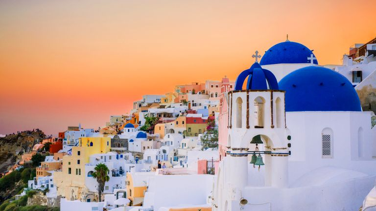 SANTORINI, GREECE - AUGUST 12: (EDITORS NOTE: Image processed using digital filters) A general view of the sunset in the picturesque village of Oia (Ia) on Santorini Island on August 12, 2017 in Mykonos, Greece. (Photo by Claudio Lavenia/Getty Images)